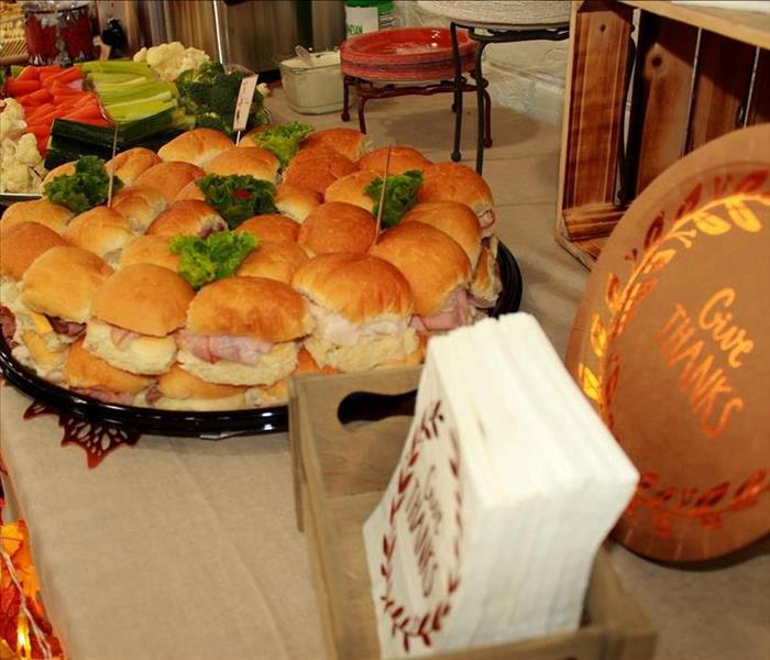 photo of sandwich tray, Thanksgiving napkins and plates on a decorated table