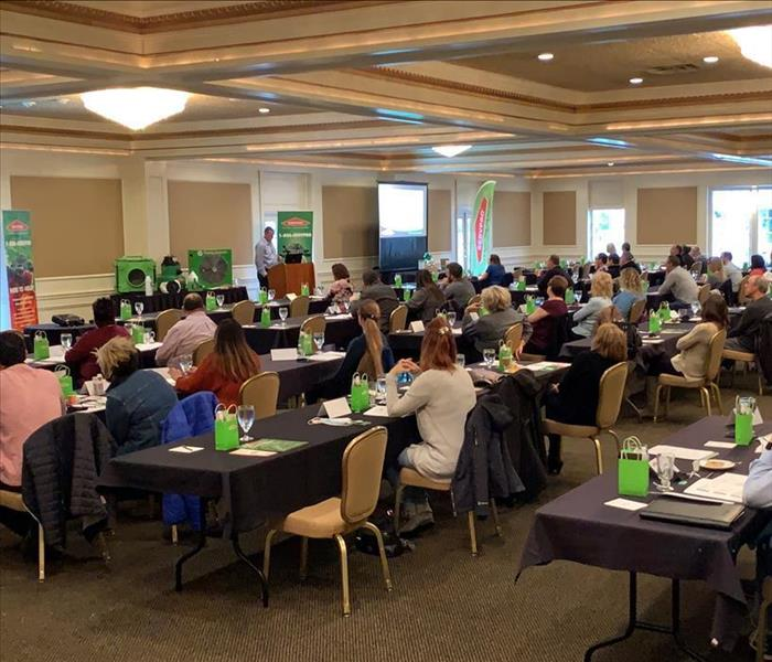 image of a room full of insurance agents taking a continuing education course offered by SERVPRO
