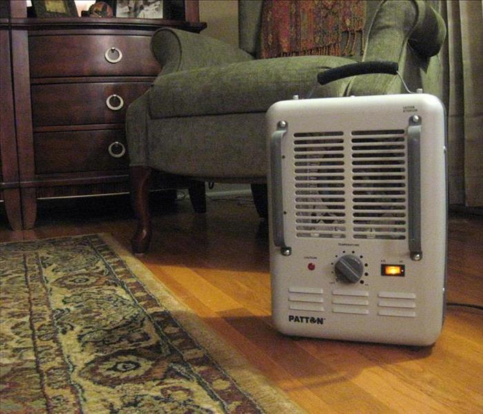 image of space heater in a living space while turned on and running