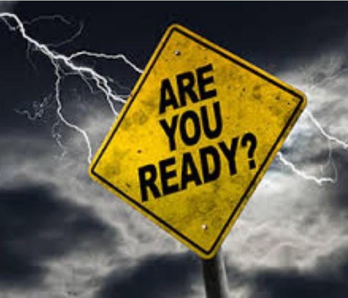"photo of road sign with text ""are you ready"" storm in the background of the sign"